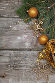 Golden Christmas decorations — Photo