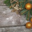 Golden Christmas ornaments — Stock Photo #16907155