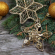 Golden Christmas ornaments — Stock Photo #16907169