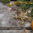 Golden Christmas ornaments — Stock Photo #16907221