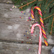 Stock Photo: Christmas candy and spruce branches