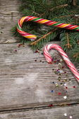 Christmas candy and spruce branches — Foto de Stock
