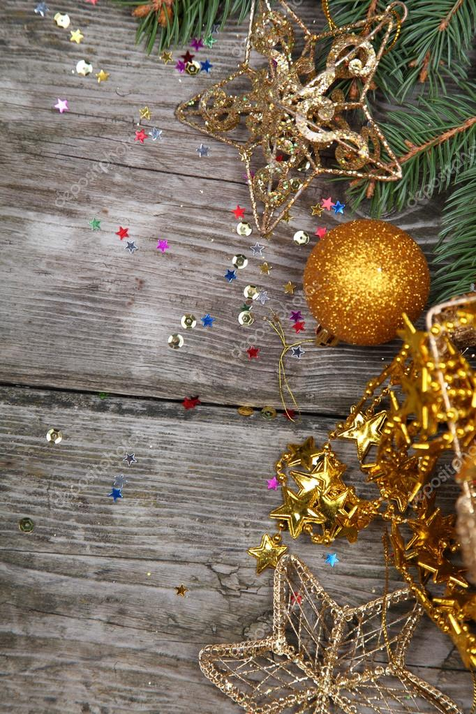 Christmas still life with golden ornaments on a wooden table  Stock Photo #16907179