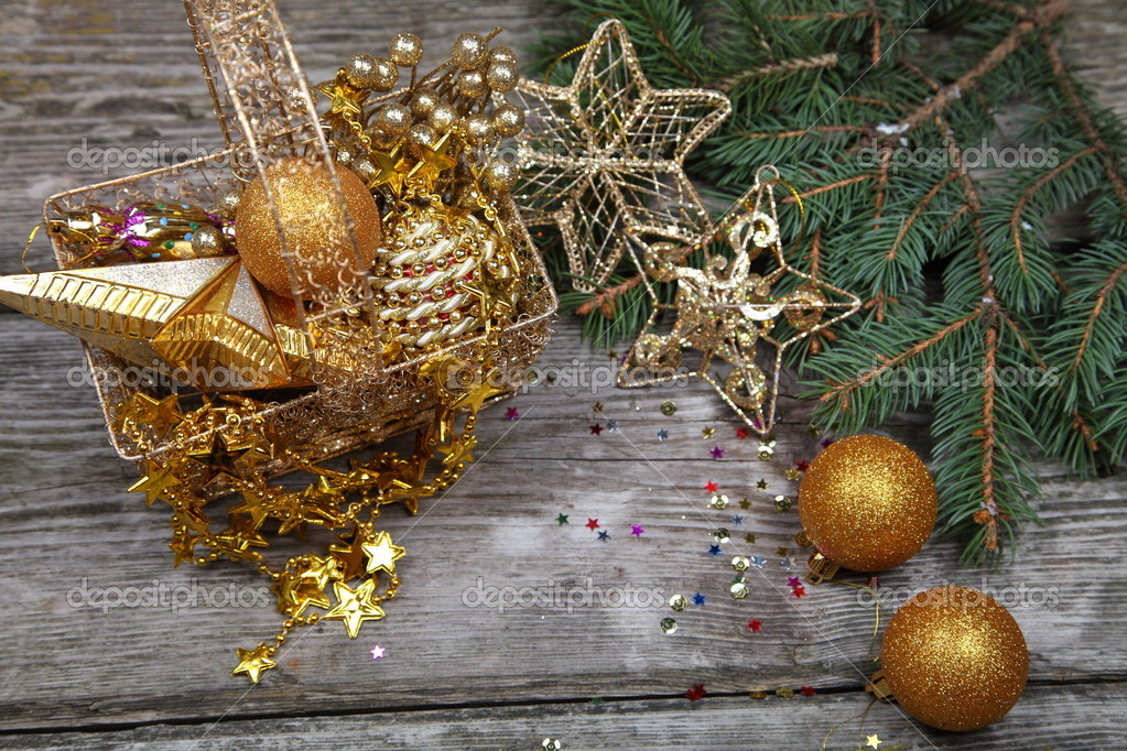 Christmas still life with golden ornaments on a wooden table — Stock Photo #16907187