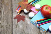 Books, pencils and maple leaf — Stock Photo