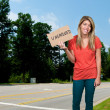 Stock Photo: WomHolding Unemployment Sign