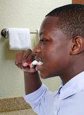 Teenage Boy Brushing Teeth — Stock Photo