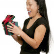 Hispanic Woman Holding a Christmas Present — Stock Photo