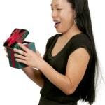 Hispanic Woman Holding a Christmas Present — Stock Photo
