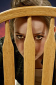 Woman Looking Through A Chair — Stock Photo