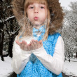 Girl Blowing Snow — Stock Photo #14365763