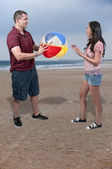 Couple with Beach Ball — Stock Photo