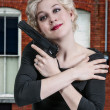 Stock Photo: WomHugging Gun