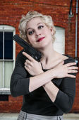 Woman Hugging Gun — Stockfoto