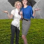 Women Holding Umbrella — Stock Photo #25530473