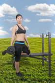Asian Woman Working with Weights — Stock Photo
