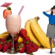 Stock Photo: Womwith Fruit Smoothie