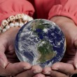 Woman holding Earth — Stock Photo #34787497