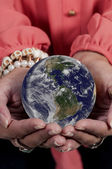 Woman holding Earth — Stock Photo