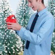 Stock Photo: Man Holding Gift