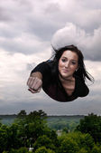 Woman Flying Through the Sky — Stock Photo