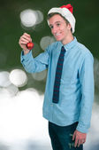 Man with Christmas Tree Ornament — Stock Photo