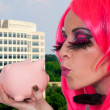 Stock Photo: Womholding piggy bank