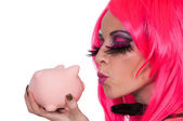 Woman holding piggy bank — Stock Photo