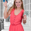 Woman Holding 100 Dollar Bills and Credit cards — Stock Photo