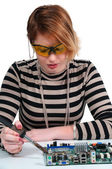 Woman soldering — Stock Photo