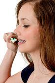 Beautiful Teenage Woman Brushing Teeth — Stock Photo