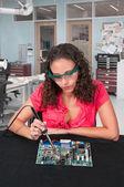 Woman soldering — Stock Photo