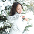 Young Woman standing by the Snow Tree — Stock Photo