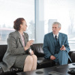 Two colleagues having a break during business meeting with cigarette — Stock Photo #10422105