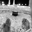 Muslim praying at Mekkah with hands up — Stock Photo #12179884
