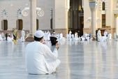 Muslim prayer at holy mosque — Stock Photo