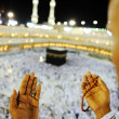 Muslim praying at Mekkah with hands up — Stock Photo
