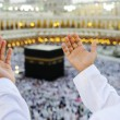 Stock Photo: Muslim praying at Mekkah with hands up
