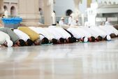 Muslims praying together at Holy mosque — Stockfoto