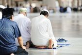 Muslims praying together at Holy mosque — Stok fotoğraf