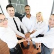 Business colleagues with their hands stacked together — Stock Photo