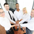 Business colleagues with their hands stacked together — Stock Photo #13334369