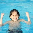 Little happy boy on pool — Stock Photo