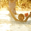 Happy children together splashing water — Stock Photo