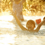 Happy children together splashing water — Stock Photo