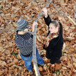 Romantic Teenage Couple By Tree In Autumn Park — Stockfoto #13335126