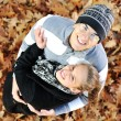 Portrait of love couple embracing outdoor in autumn park — Stock Photo