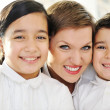 Stock Photo: Mother and children at home