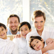 Happy family with kids on the couch — Stock Photo #13335337