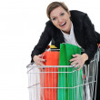 Young woman with shopping cart isolated — Stock Photo